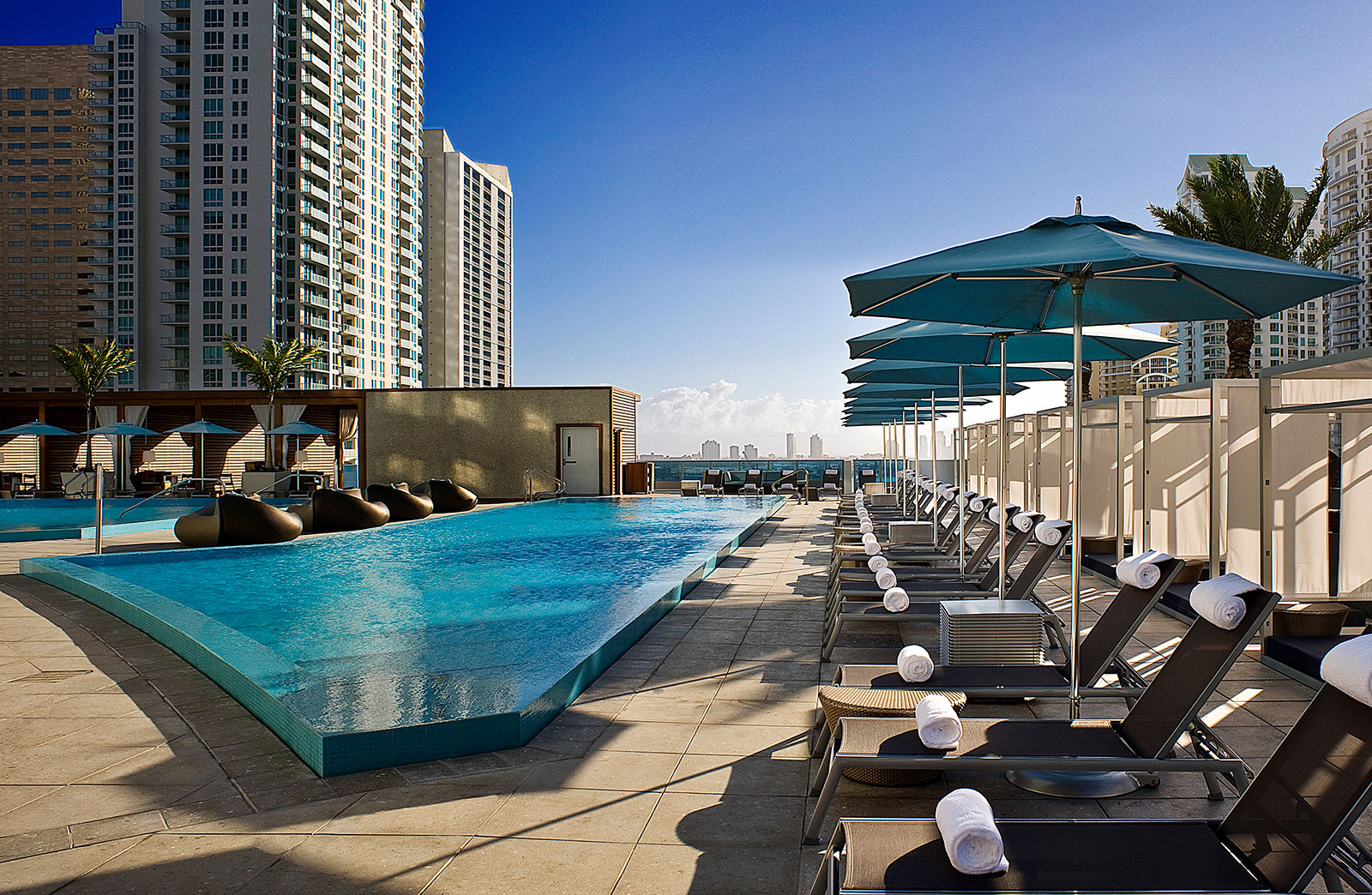 Pool and lounge area for high-end hotel overseen by hotel asset management services and hotel consulting firm, hotelAVE