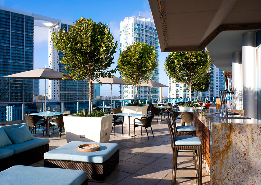 Outside view of a luxury city rooftop hotel restaurant and bar managed by hospitality operations company, hotelAVE