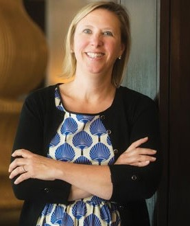 Professional headshot of Michelle Russo, founder of successful hotel asset management company: hotelAVE