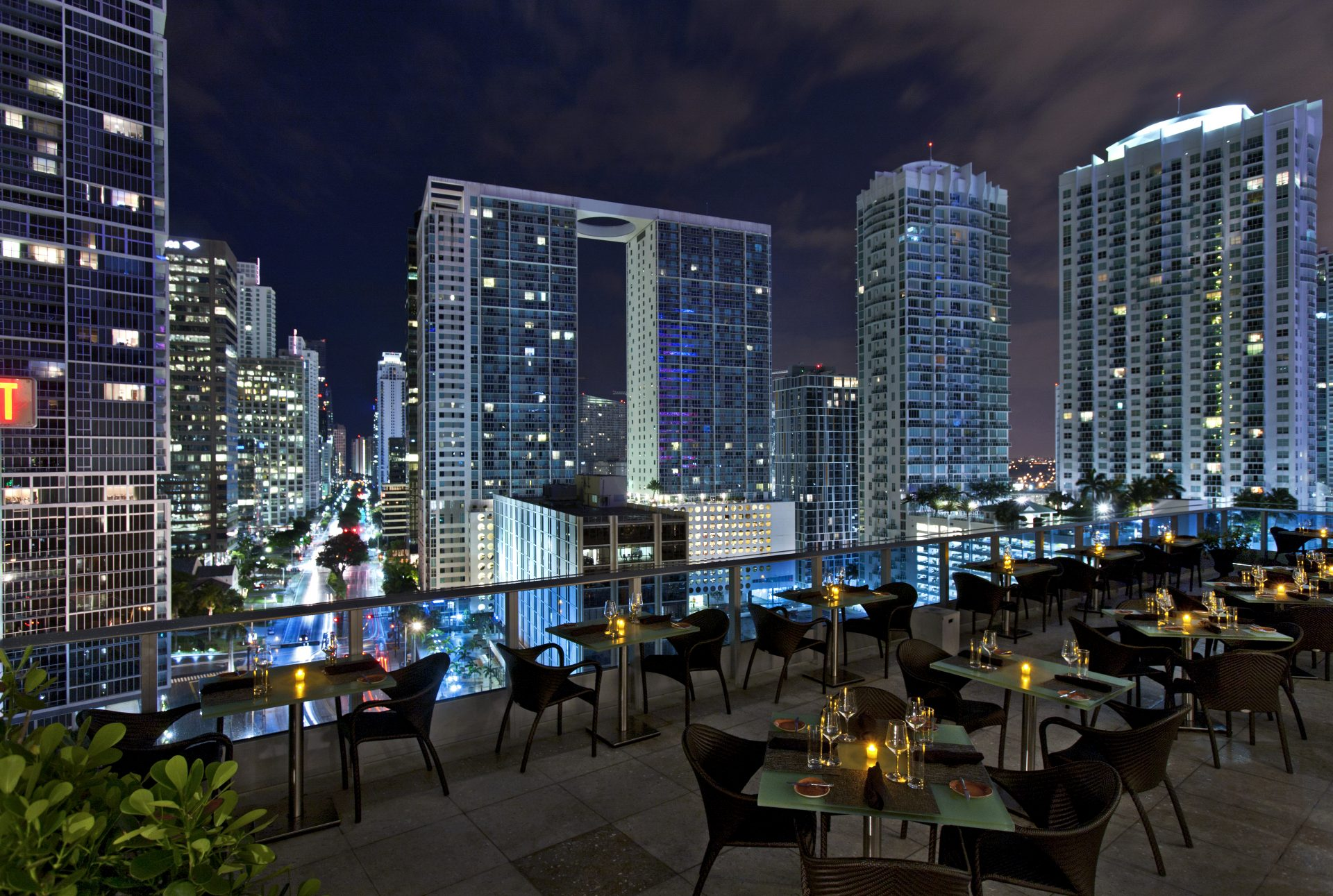 View of city skyline from rooftop restaurant of luxury hotel managed by hotel asset management services firm, hotelAVE