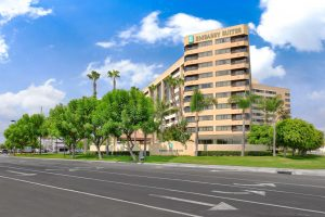 Exterior view of Embassy Suites Anaheim, a hotel overseen by hospitality operations and hotel asset management firm, hotelAVE