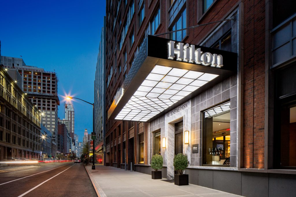 Entrance of the Hilton Brooklyn hotel, managed by hospitality operations and hotel asset management company, hotelAVE